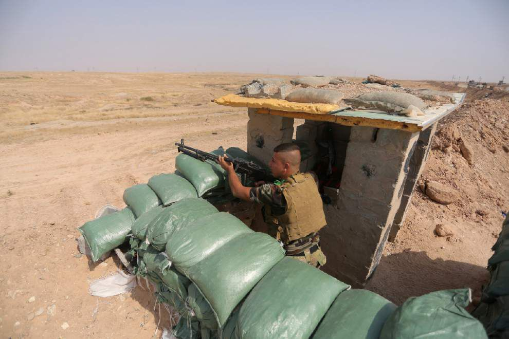 Officials: Islamic State group downs Iraqi chopper _lowres