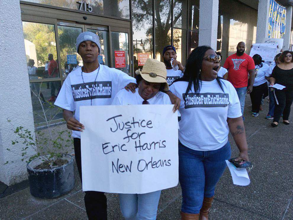 Video: Dozens with 'Black Lives Matter' signs appear at New Orleans police headquarters to protest Eric Harris' fatal shooting _lowres