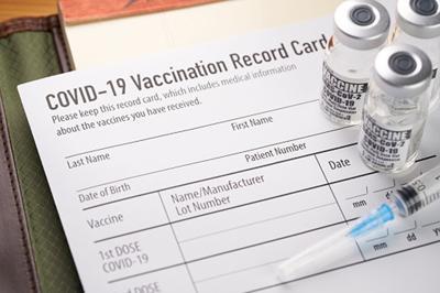 vaccine card with vaccine bottle.jpg