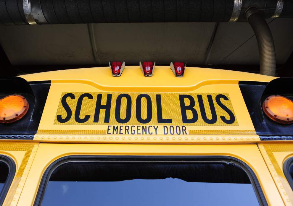 School Board approves bond purchase; money to be used to buy buses, build high school _lowres