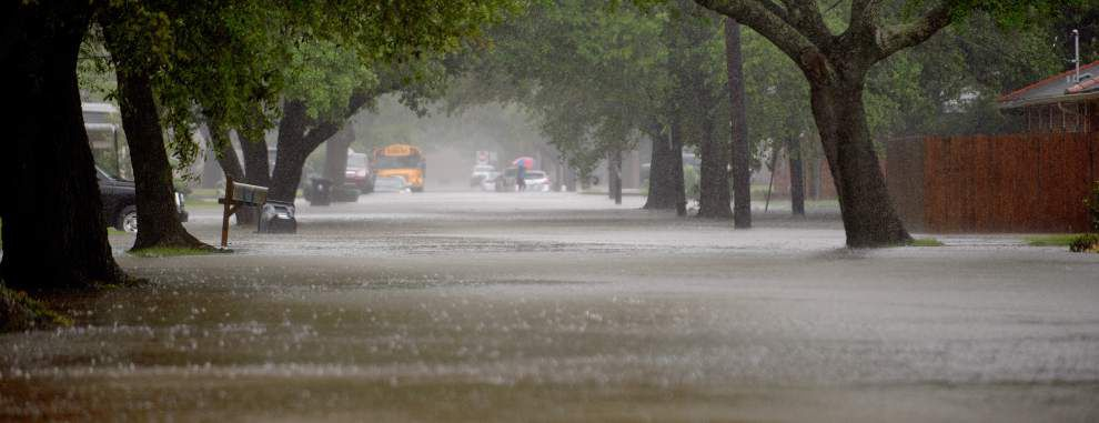 Flooded streets and floating garbage cans: Photos of Friday's soggy mess in New Orleans _lowres