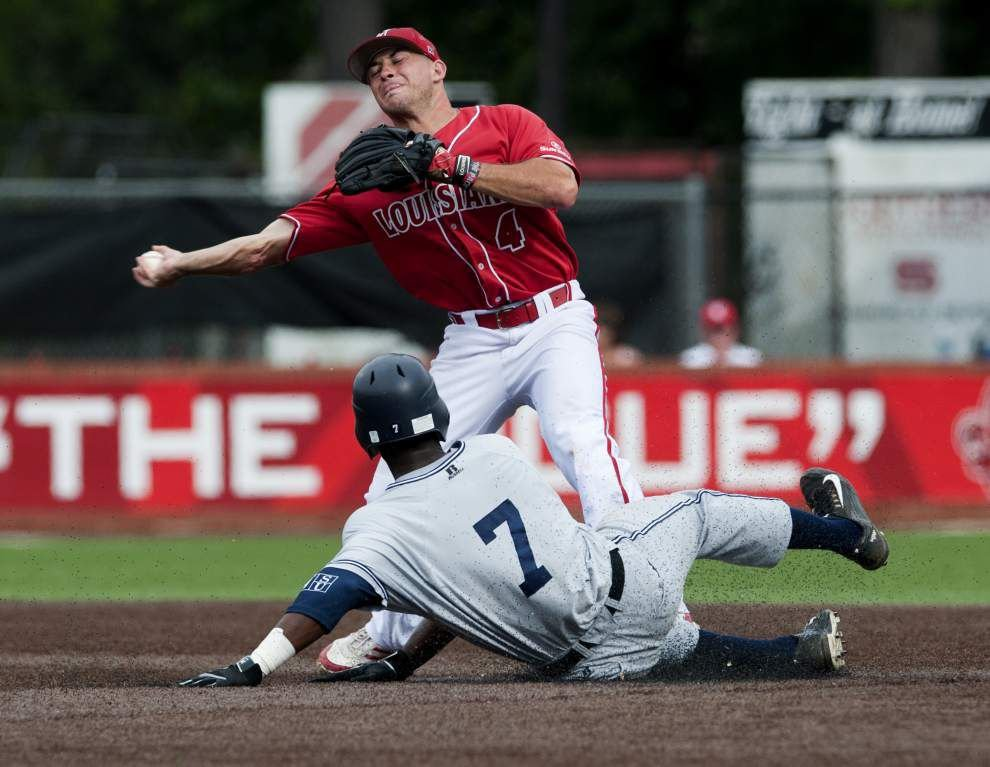Ragin' Cajuns' Blake Trahan has become handy with the leather _lowres