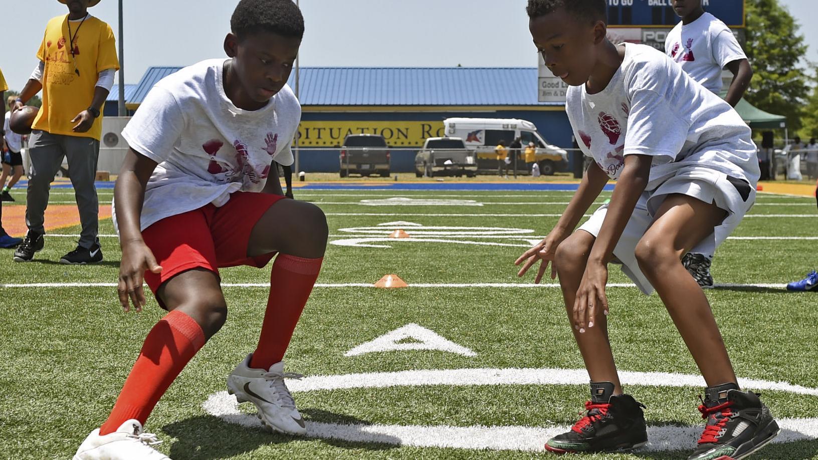 Photos: Young football players sharpen skills at Doug Williams Football Camp
