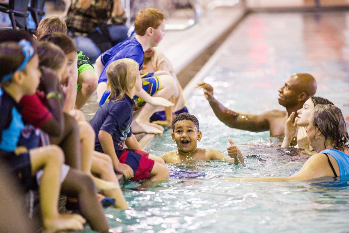Olympic champ who nearly drowned visits New Orleans to help