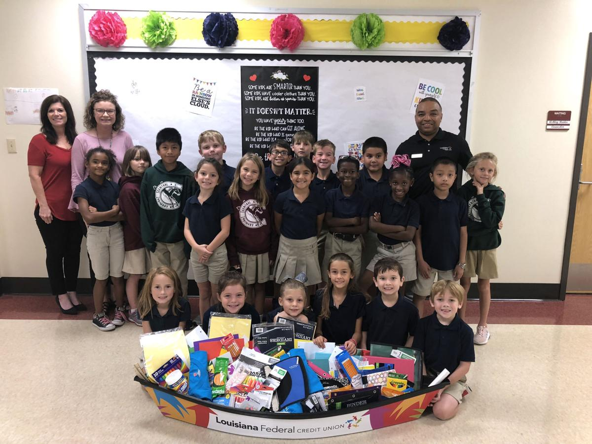 Central Primary School Classroom Unloads Pirogue Of Donated Supplies