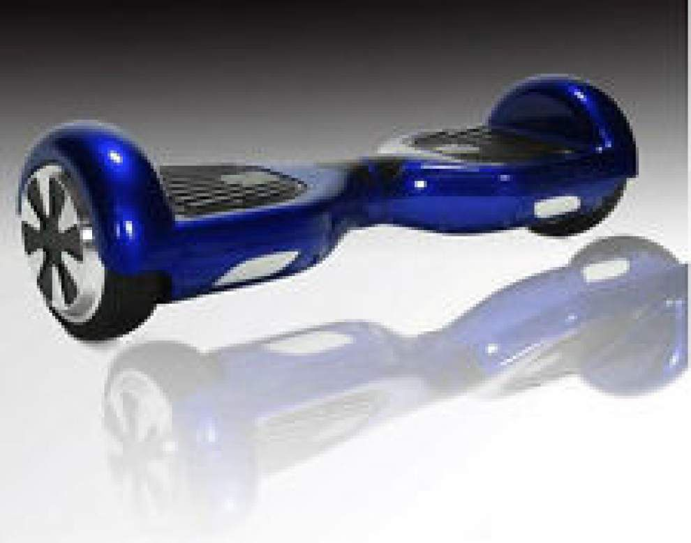 Another 'hoverboard' bursts into flames in Louisiana; experts urge caution in purchasing the popular gadgets _lowres
