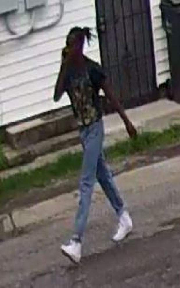 Police search for person of interest in killing of anti-violence 'ambassador' and his friend _lowres