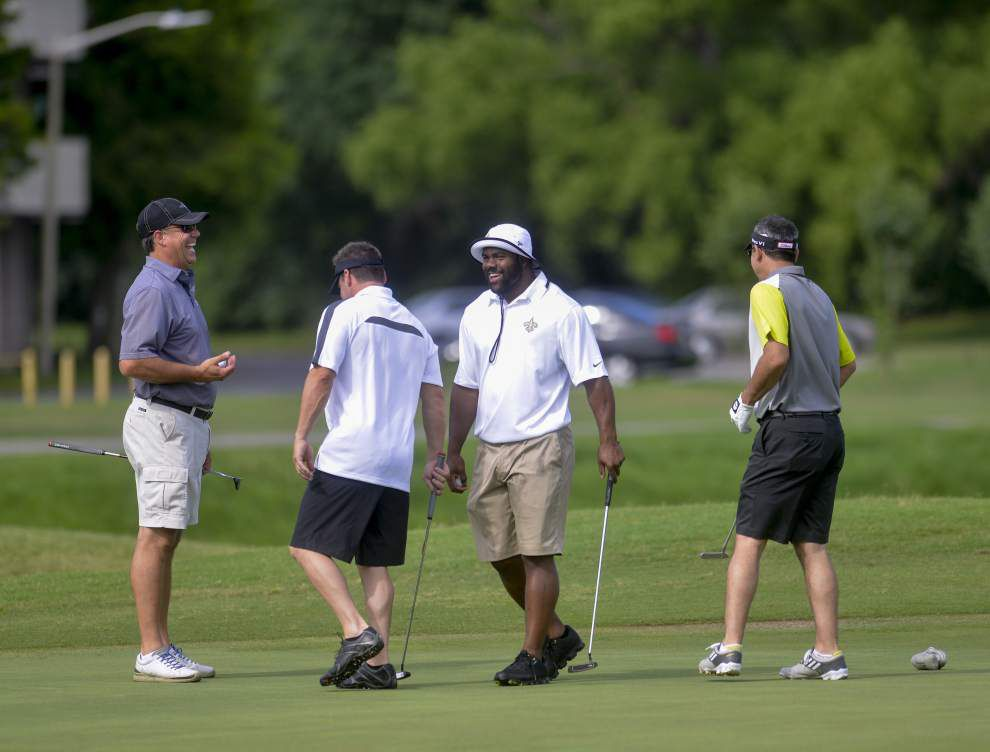 Photos: View how some New Orleans Saints execute a drive -- on the golf course _lowres