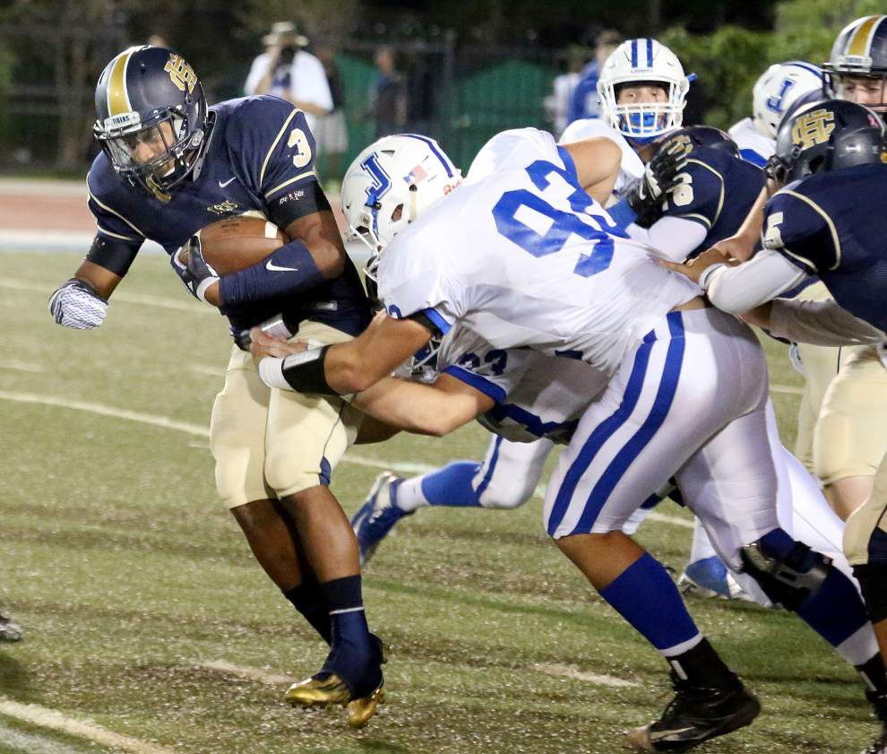 Holy Cross topples Jesuit 28-21 in double overtime _lowres