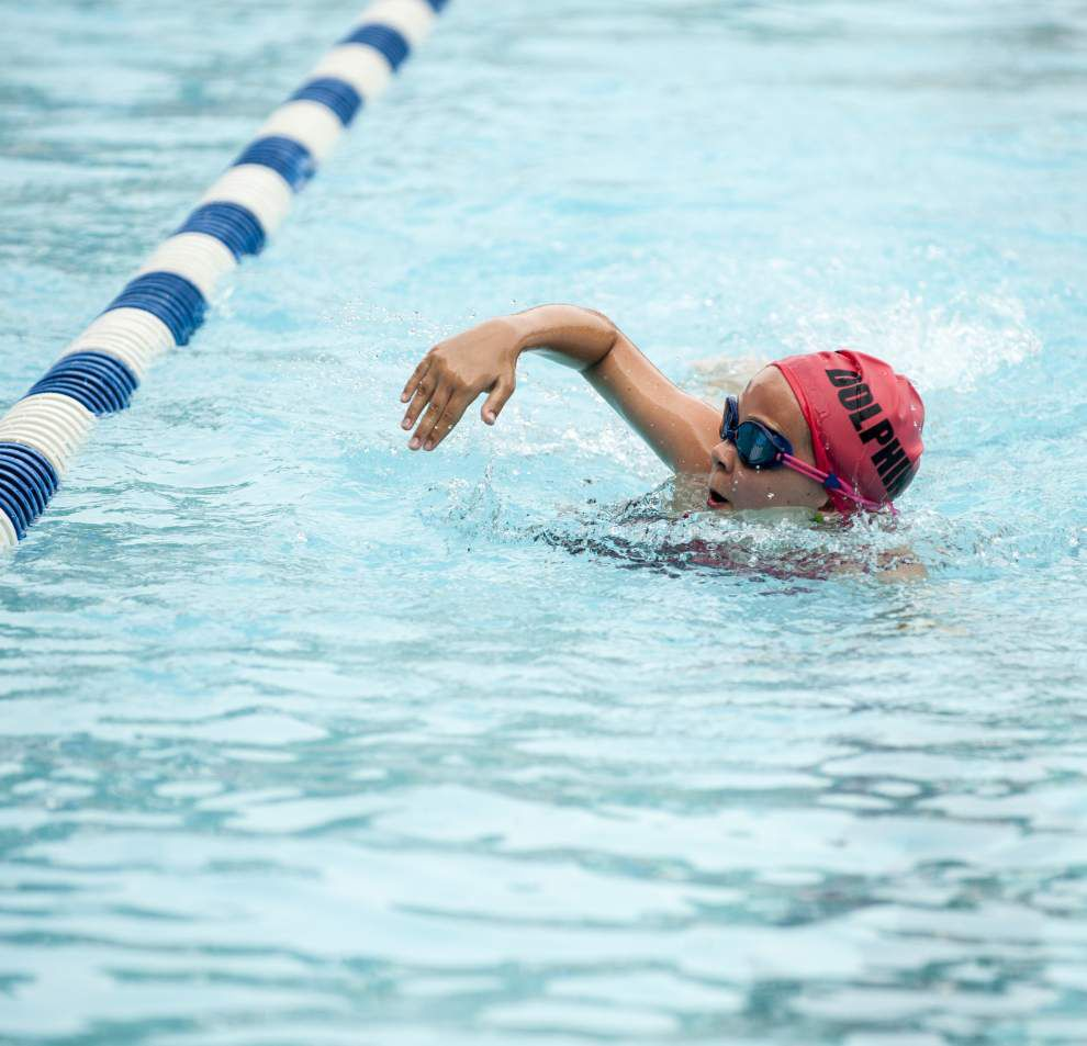 College students take on challenges of coaching for Gonzales swim team _lowres