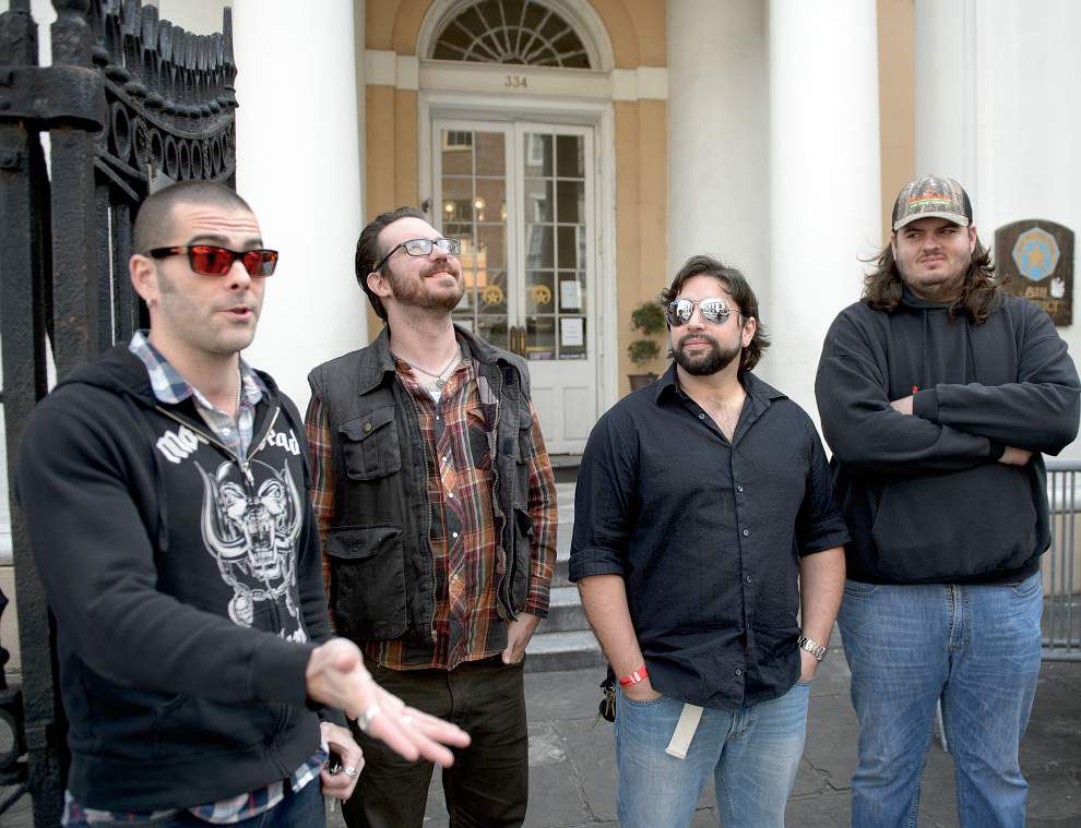Band members find stolen Rodrigue Blue Dog painting leaning against St. Louis Street building, return it to NOPD _lowres