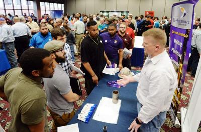 About 1,800 anxious jobseekers crowd Lafayette's Cajundome looking for employment in petrochemical industries _lowres