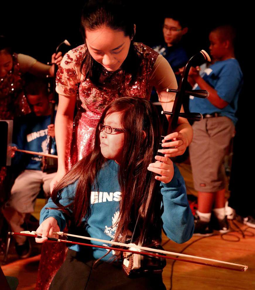 Photos: New Orleans charter school gets a musical treat from the Far East _lowres