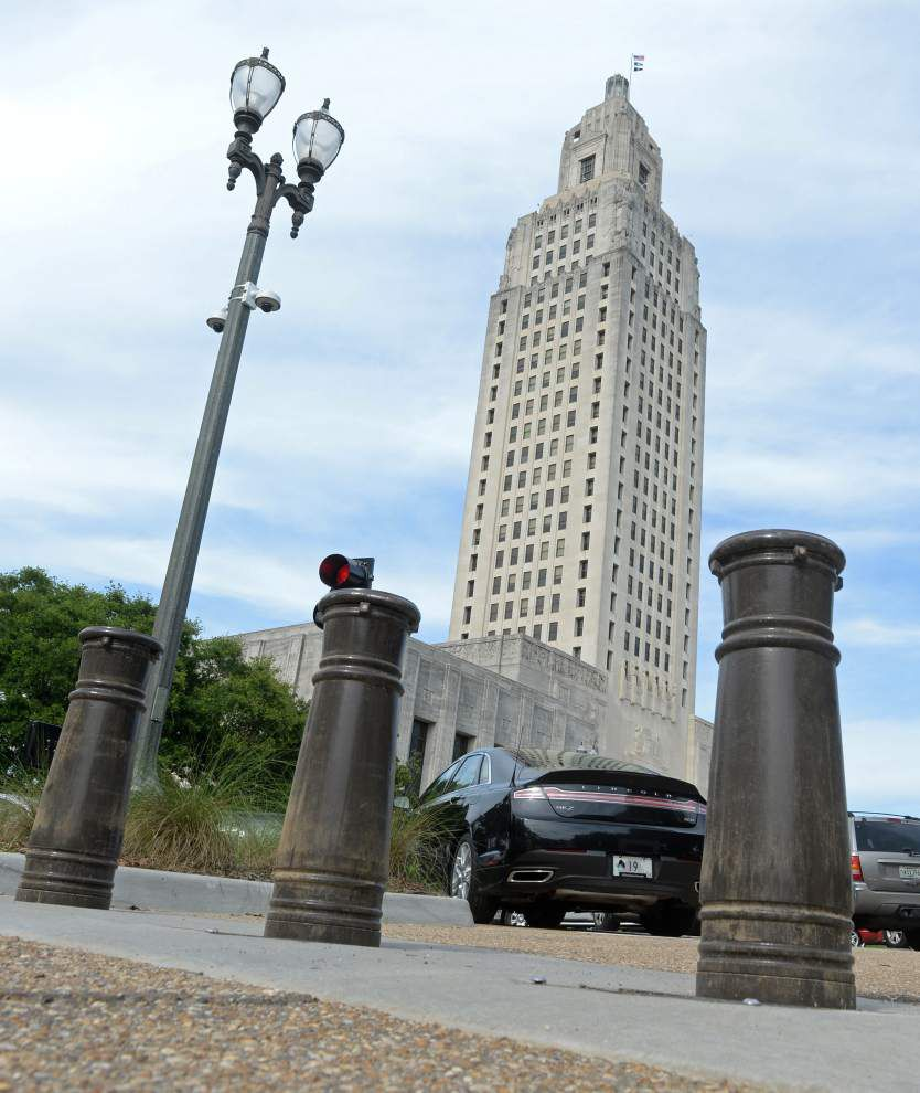 And again... State Capitol bollards wreck another car _lowres
