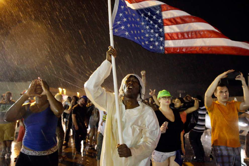 Ferguson man shoots officers who return fire, critically injure protestor _lowres