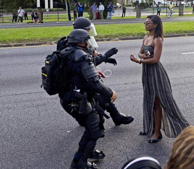 The Alton Sterling photo everyone is talking about: Who's the woman? Why is she so calm? _lowres