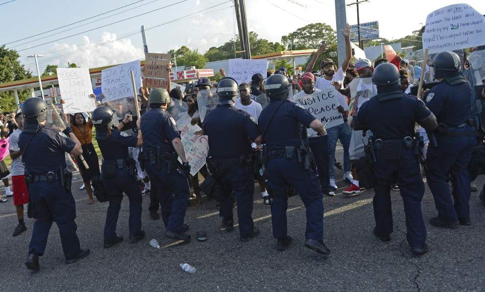 See photos, video as Baton Rouge police officer draws gun, tensions rise at Alton Sterling protest Friday night _lowres