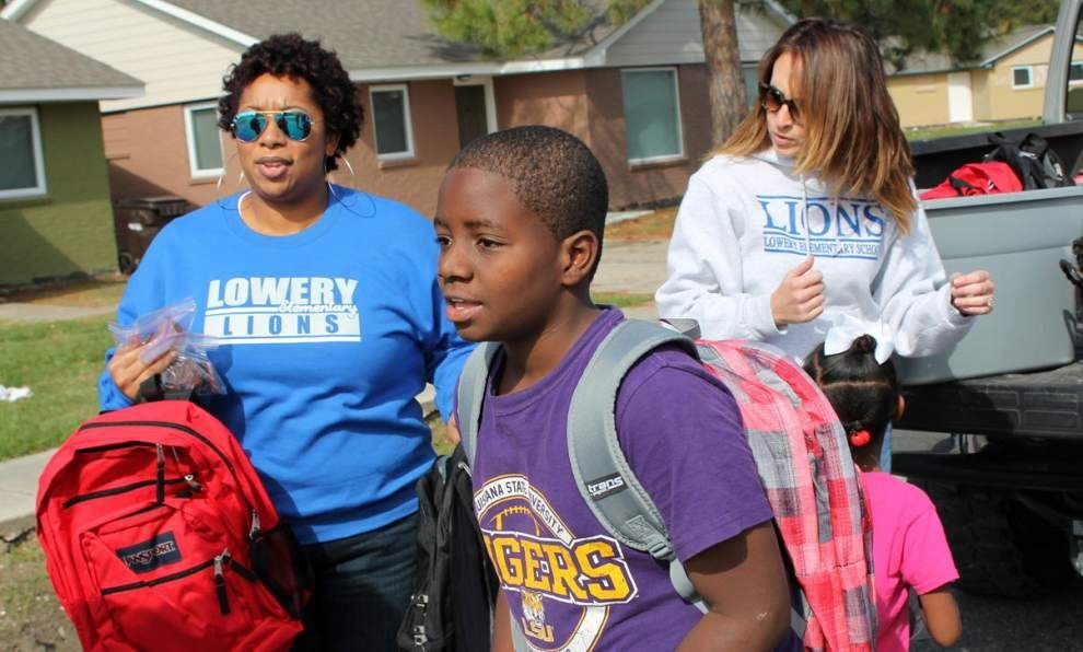 Lowery staff surprises elementary students with backpacks, holiday treats _lowres