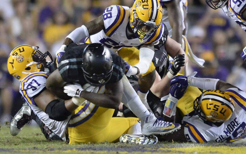 Photos: Wild, wacky, emotional game day ends with victory, LSU coach Les Miles carried off field by players _lowres