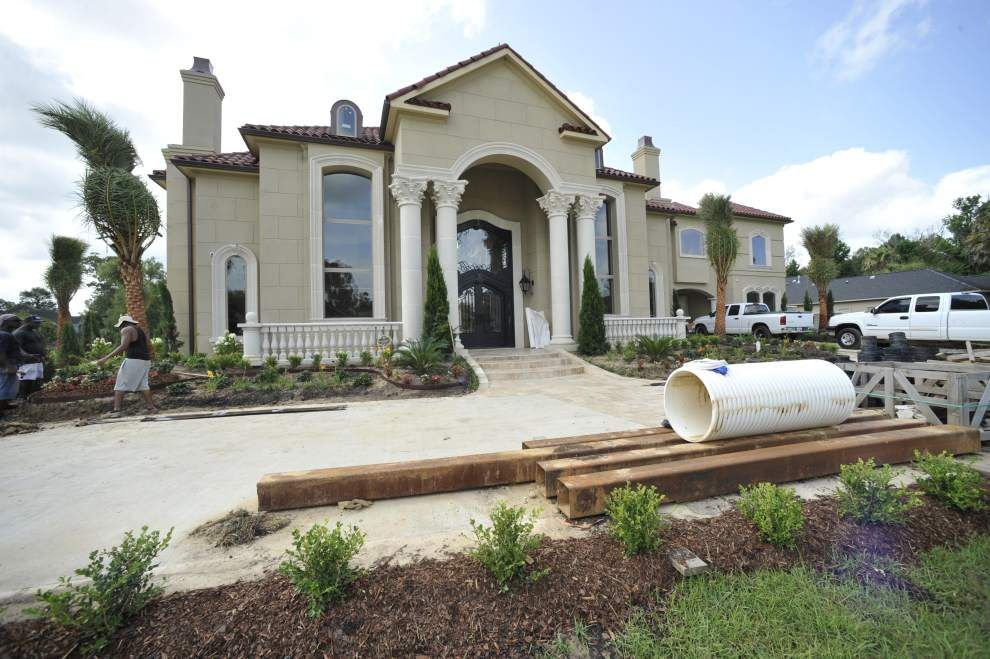 Mansion, luxury cars among drug ring spoils _lowres