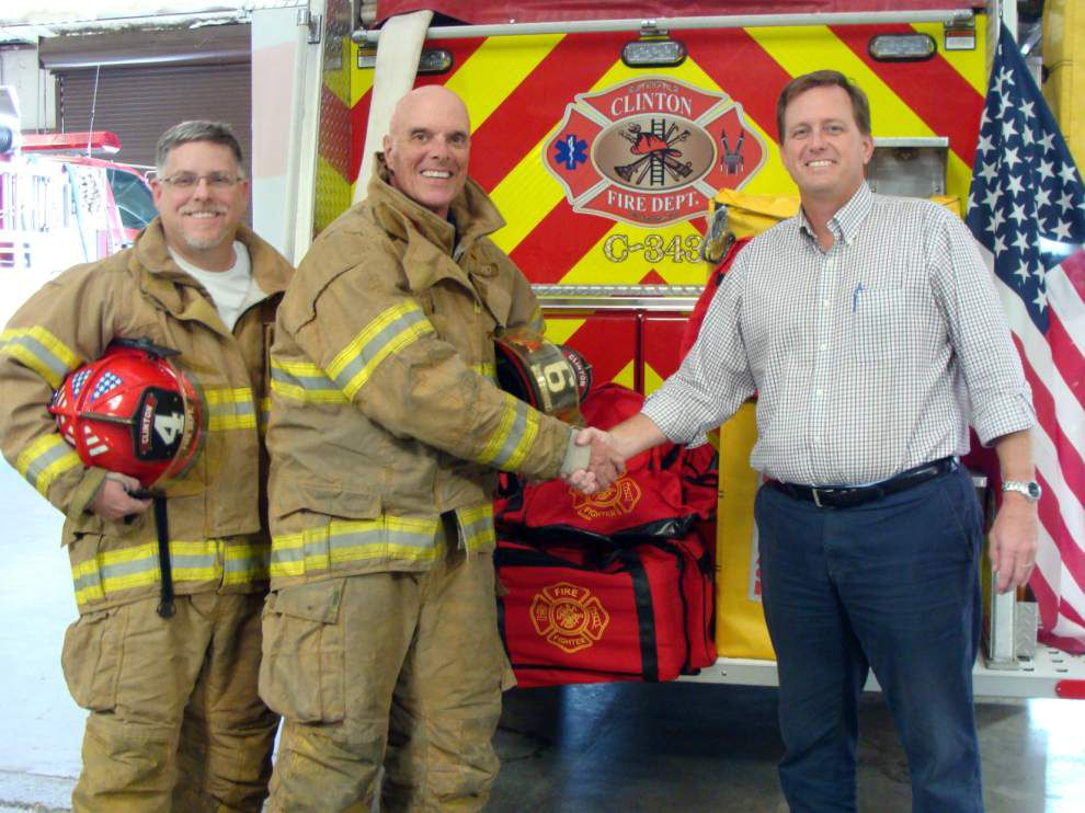 Clinton firefighters receive donation from PacTec Inc. _lowres