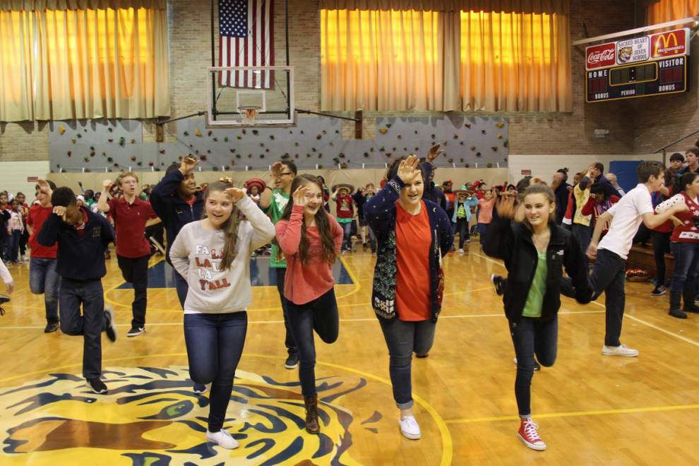 Sacred Heart of Jesus celebrates with tree decorating, fashion _lowres