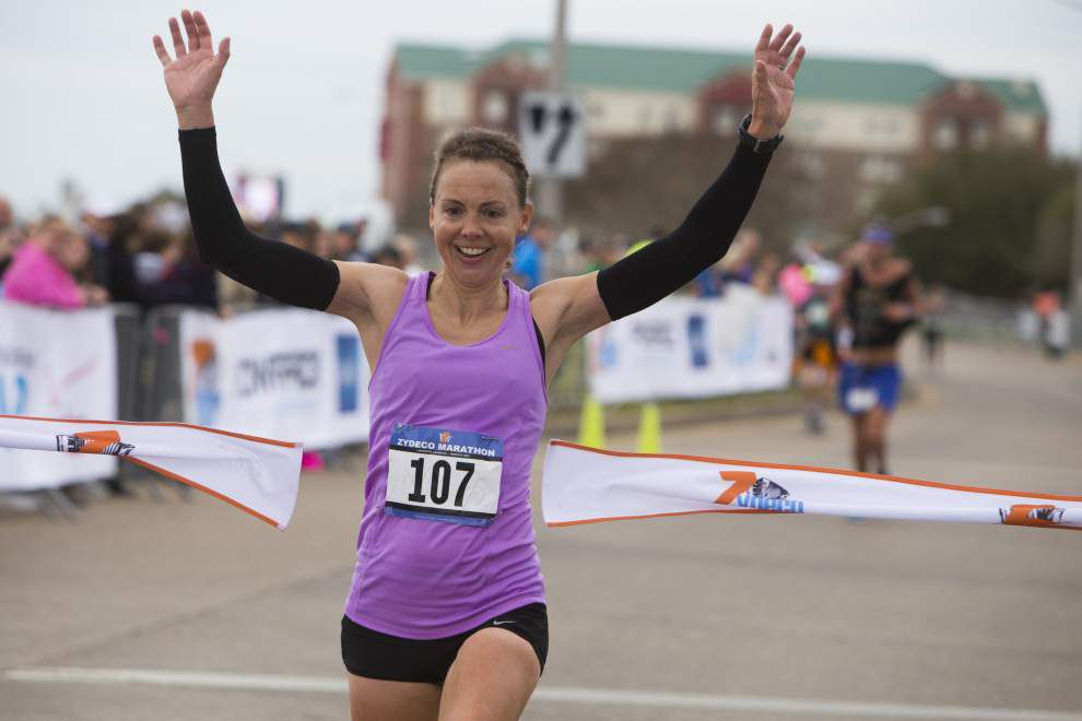 Thousands pound the pavement in the second Zydeco Marathon; path took runners through Lafayette's landmarks _lowres