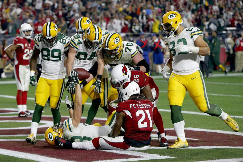 Hail Mary to Hail Larry: Packers force overtime, then fall to Cardinals on Fitzgerald touchdown _lowres