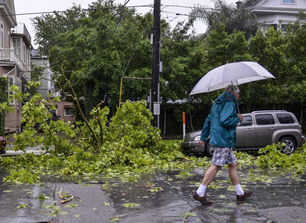 Photos: Trees down, streets flooded and train cars toppled as severe storm hits New Orleans _lowres
