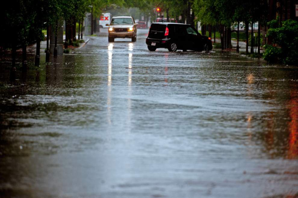 Photos: Torrential rain causes widespread street flooding across New Orleans area on Tuesday _lowres