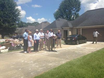 President Obama visits flood-damaged neighborhood in Zachary.