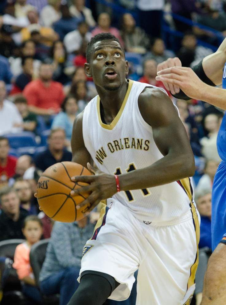 Pelicans guard Jrue Holiday to miss two to four weeks with a stress reaction in his lower right leg _lowres