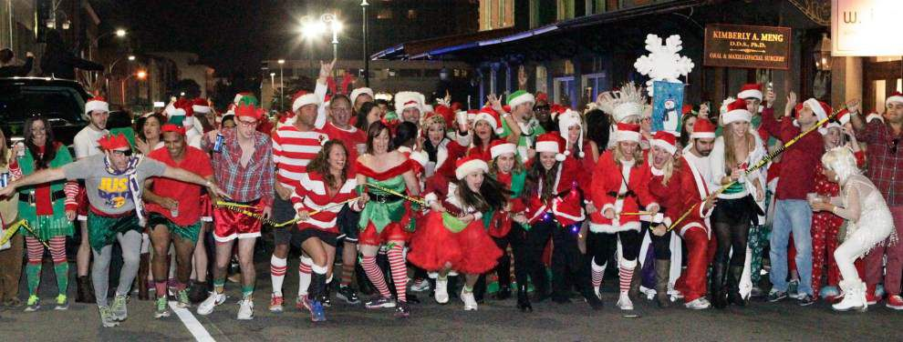 Festive pub crawl Running of the Santas headed to downtown Baton Rouge in December _lowres
