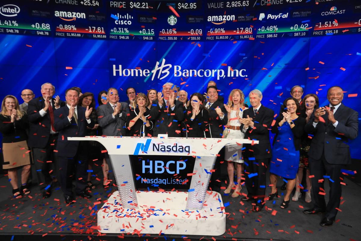 Home Bank officials mark company anniversary with ringing of