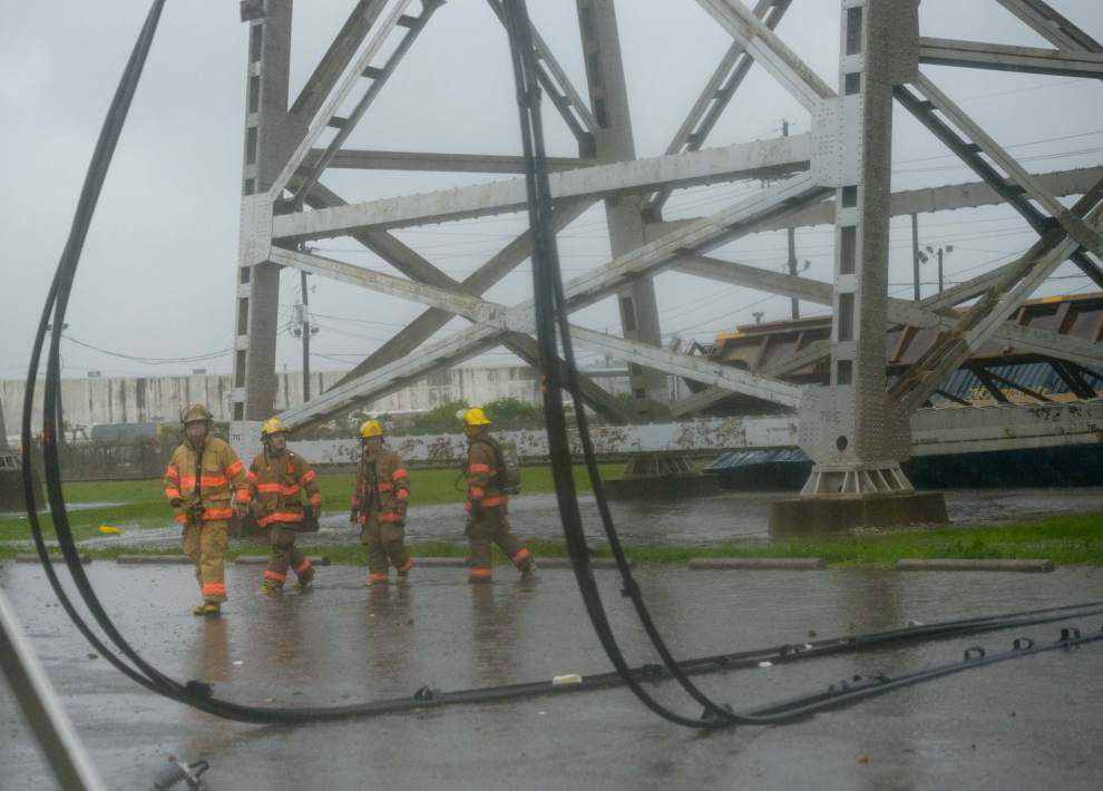 Photos: Cleaning up after storm blows train cars off bridge in Metairie _lowres