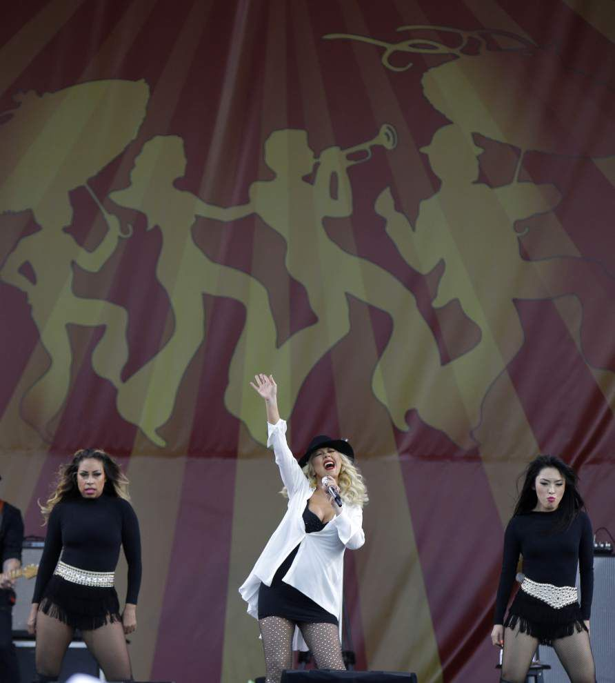 Aguilera plays to crowd with powerful voice and lots of trappings _lowres