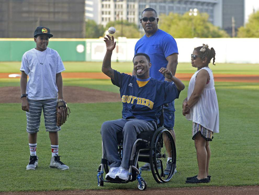 Video: Paralyzed Southern football player Devon Gales throws out 1st pitch at Southern vs. LSU baseball _lowres