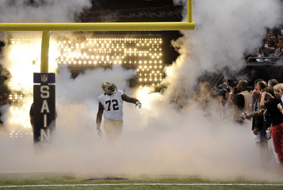 Saints rising star Terron Armstead celebrates his big contract by getting back to work _lowres
