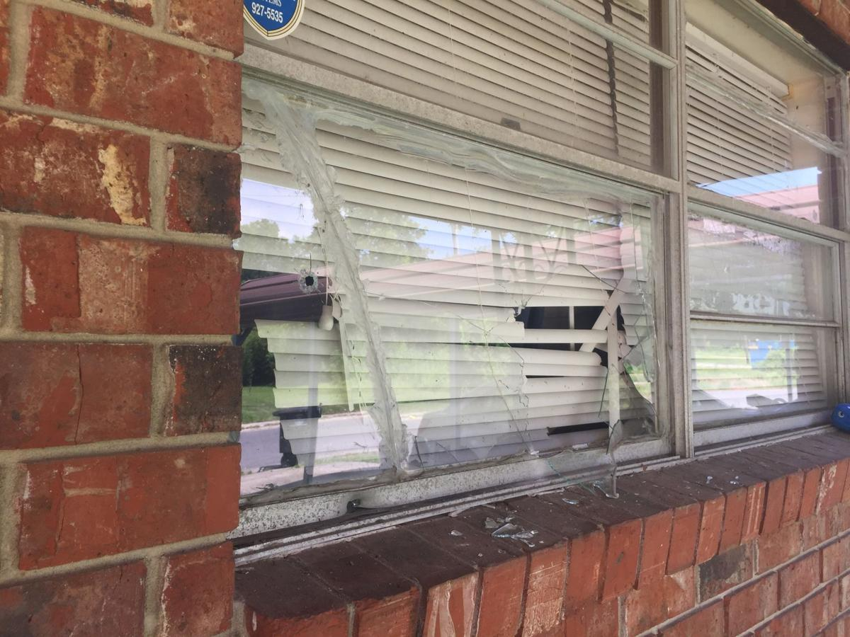 1058 Townsley Street bullet hole.jpg