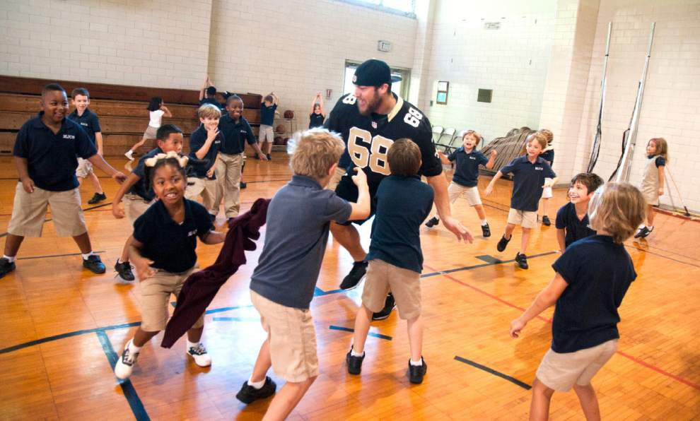 Ted Lewis: New Orleans Saints' spirits lifted by school kids, fans, family and even a chameleon _lowres