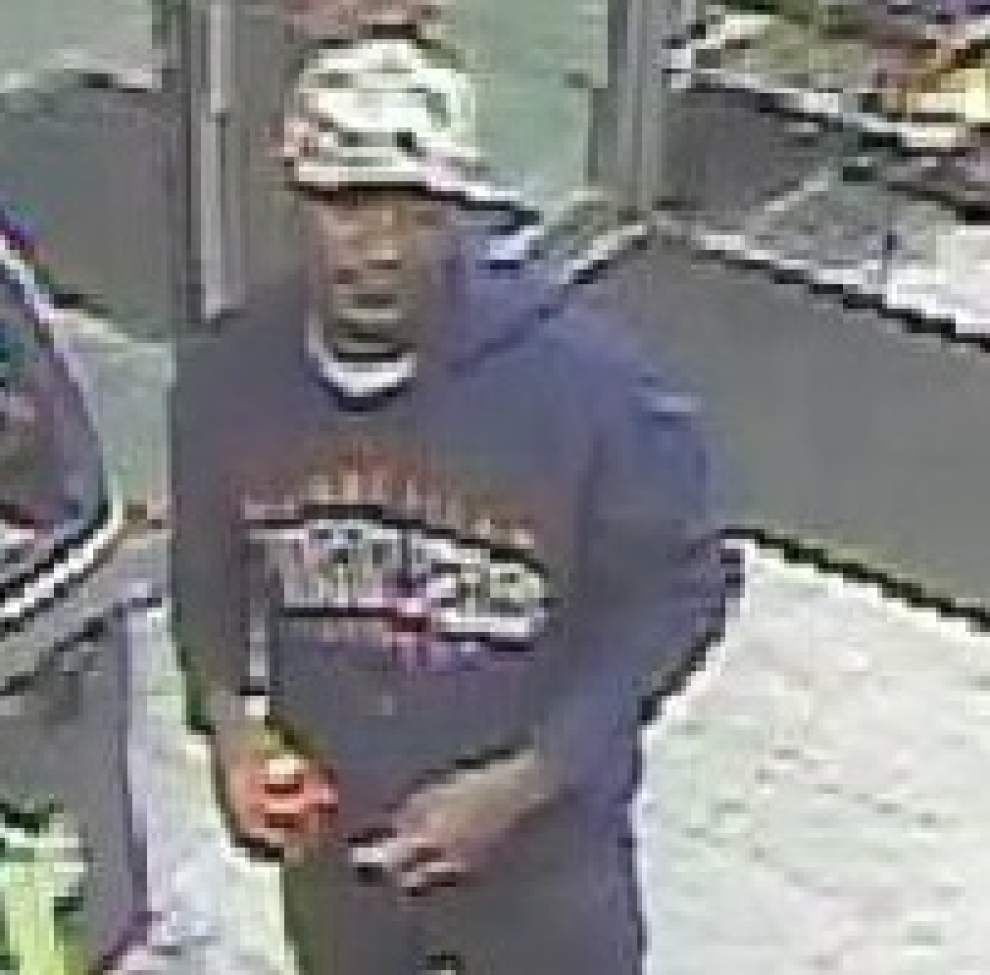 Police seek suspect in robbery of Tigerland business, was wearing 'American Hustler' shirt _lowres