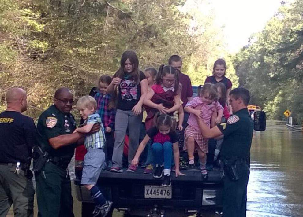 Deputies come to the rescue after school bus becomes stranded in high water in East Baton Rouge _lowres