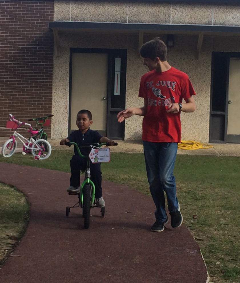 St. Jude the Apostle's Beta Club gives bicycles _lowres