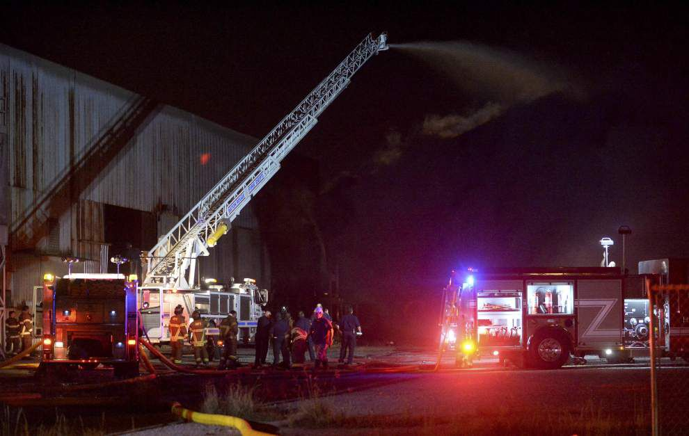 Warehouse goes up in flames because of burning rubber stored inside, fire officials say _lowres