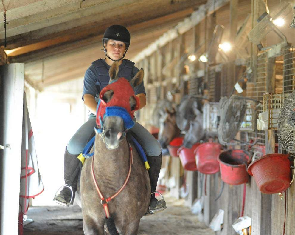 Lafayette Parish teen Andrea Owens rescues some thoroughbreds, retrains them for nonracing sports. _lowres