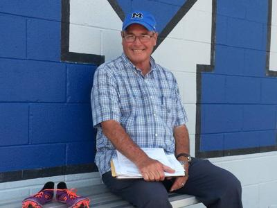 Coach Gerald Singer, who is retiring after this season, and Mandeville senior girls track team members working on fitting last hurrah _lowres