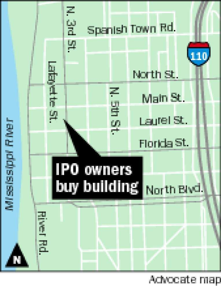 Restaurant IPO owners buy building _lowres