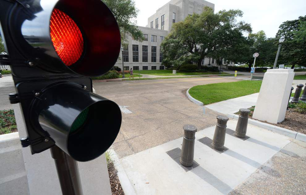 State Capitol bollards damage staff attorney's Jeep; security device has damaged 15 vehicles this year _lowres
