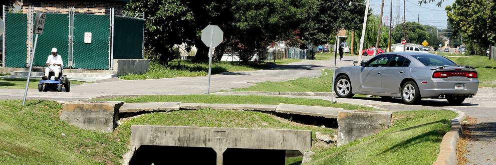 Gretna council decides to jump-start project to repair sections of sidewalk eroding into canal _lowres