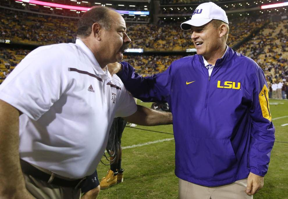 What was said in the brief chat between John Chavis, Les Miles? 'Love you'; 'Love you too'; fist bump _lowres